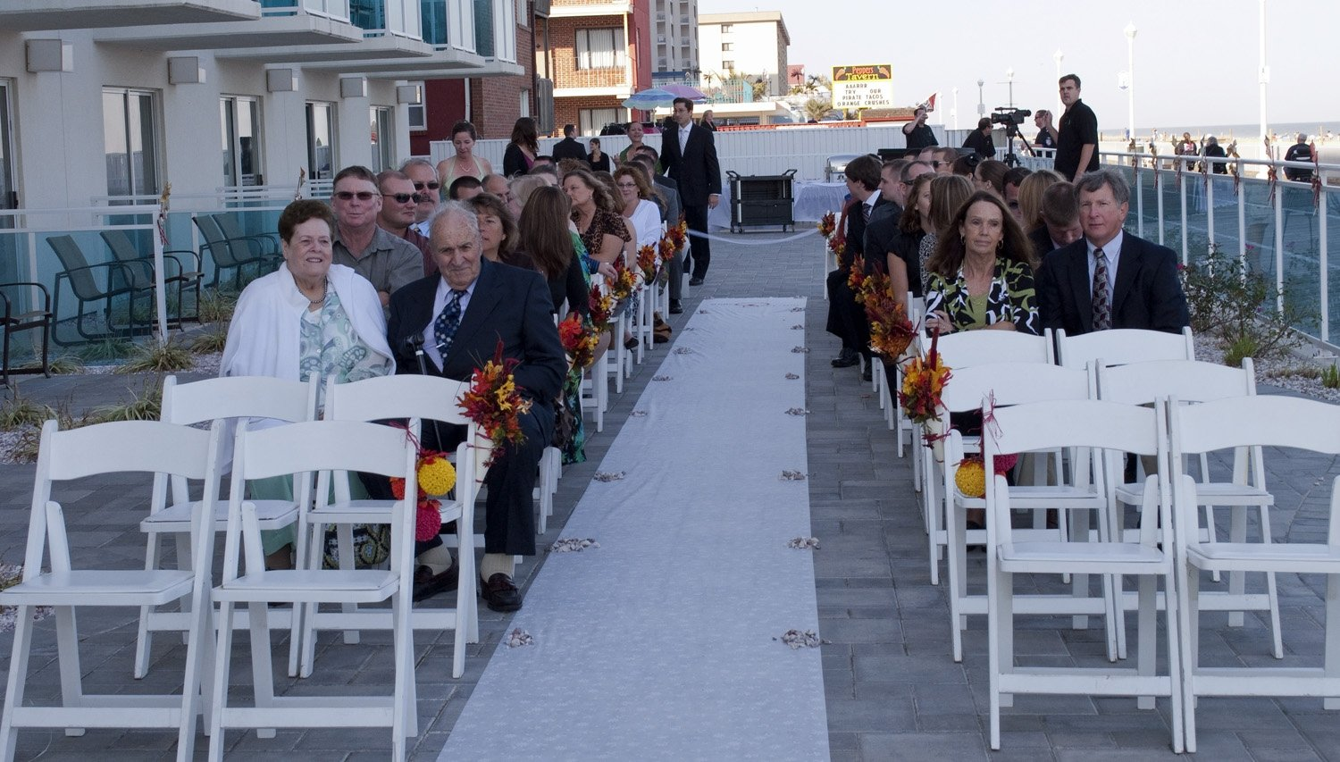 rows of white chairs at wedding on rooftop