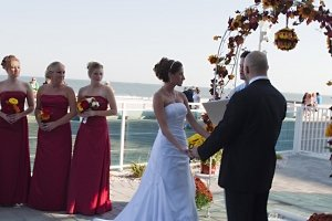 bride and groom getting married near beach