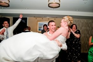 groom lifting up bride