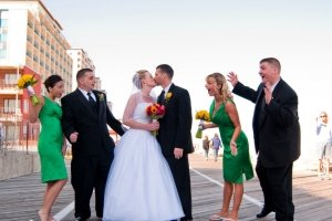 bride and groom on boardwalk